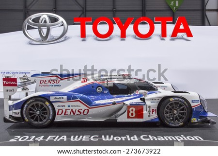 GENEVA, SWITZERLAND â?? MARCH 3, 2015: The Toyota TS040 HYBRID racing car at the Geneva Motor Show. The Le Mans Prototype develops over 1,000 PS with the engine and hybrid. - stock photo