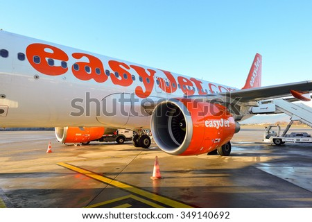 GENEVA, SWITZERLAND - NOVEMBER 18, 2015: easyJet aircraft at Geneva Airport. EasyJet is a British low-cost airline carrier, owing to its all-economy class fleet - stock photo