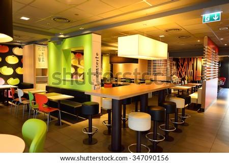 GENEVA, SWITZERLAND - NOVEMBER 19, 2015: McDonald's restaurant interior. McDonald's is the world's largest chain of hamburger fast food restaurants, founded in the United States. - stock photo