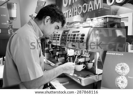 GENEVA, SWITZERLAND - SEPTEMBER 11, 2014: barmen prepare coffee. Geneva is the second most populous city in Switzerland and is the most populous city of Romandy - stock photo