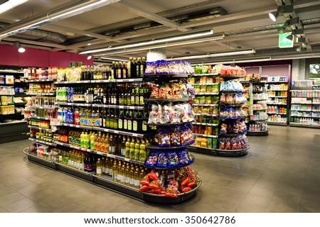 GENEVA, SWITZERLAND - SEPTEMBER 18, 2015: interior of Migros supermarket. Migros is Switzerland's largest retail company, its largest supermarket chain and largest employer - stock photo