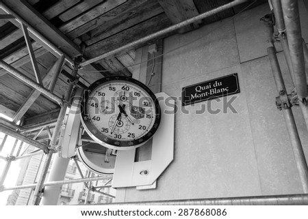 GENEVA, SWITZERLAND - SEPTEMBER 11, 2014: TAG Heuer clock on the wall. TAG Heuer S.A. is a Swiss manufacturing company that designs, manufactures and markets watches and fashion accessories