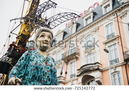 Geneva, Switzerland - September 30, 2017: The grandmother giant walking in the street of Geneva, by Royal De Luxe company Nantes France