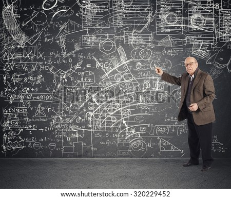 Genius aged teacher explains a complicated lesson - stock photo