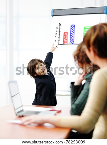 Genius kid on business presentation speaking to adults and giving them a lecture - stock photo