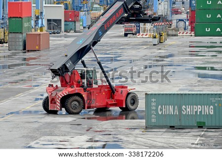 GENOA, ITALY - APRIL 1, 2013: Maritime personnel and equipment to work on the docks of the commercial port of Genoa. In the picture, the terminal SECH.