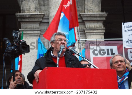 "GENOA, ITALY-DECEMBER 12 - national general strike against the government Renzi and the ""jobs act"" on stage in Genoa national secretary  metalworkers Maurizio Landini- Genoa, Italy on dec 15  2014"