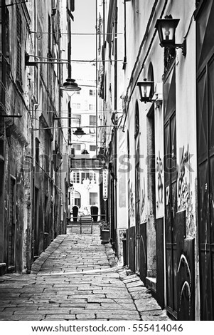 GENOA, ITALY - MAY 11, 2013 Paved narrow street in old town Genoa, Italy, black and white view