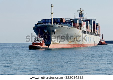 GENOA, ITALY - OCTOBER 16, 2009: Cosco container vessel Luhe. She measures a length of 280m and beam of 40m. The ship enters in the port of Genoa.