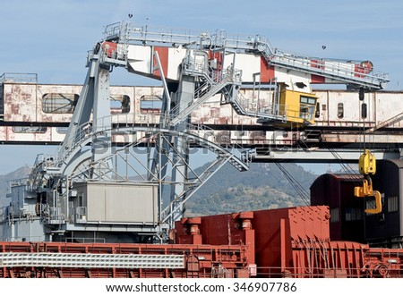 GENOA, ITALY - OCTOBER 29, 2011: The cockpit and pilot of a crane on the docks of the commercial port of Genoa.