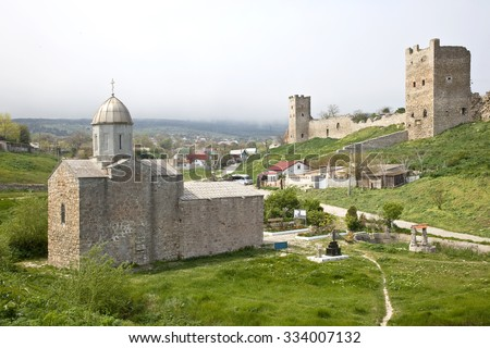 Genoese fortress and ancient Orthodox church Iverskoi Mother of God in the city of Feodosia - stock photo