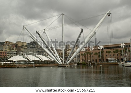 Genova old Port Harbor with it's attractions in a cloudy day
