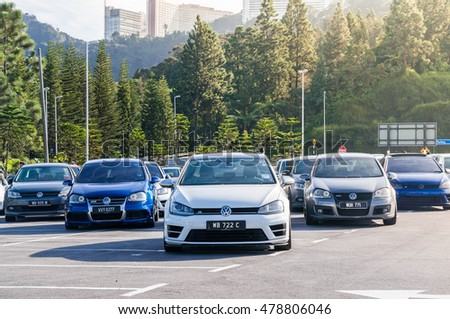 GENTING, MALAYSIA - September 4, 2016: A group of Volkswagen cars parking on the side road. Photo at Jalan Genting road 15 min to Genting Highland.
