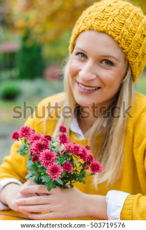 Gentle and cute blonde girl posing and looking shyly at the camera