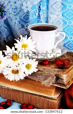 Gentle autumn still life with books and cup of tea close-up - stock photo