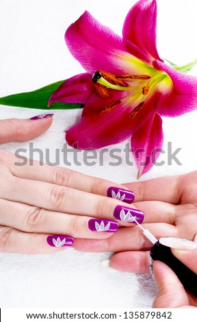 Gentle care of nails in a beauty salon - stock photo