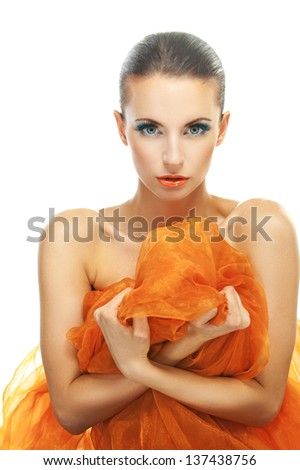 Gentle charming young woman hold in hands orange shawl, on white background. - stock photo