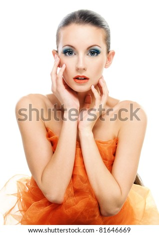 Gentle charming young woman in orange shawl, on white background. - stock photo