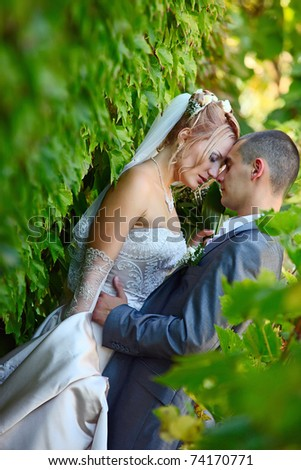 Gentle embrace of a newly-married couple - stock photo