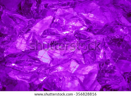 Gentle glare glisten depth dark lavender color druse birthstone stack, mysterious lit by vivid mauve glow. Close-up view with space for text on clear romantic refraction sparkle ice particle heap - stock photo
