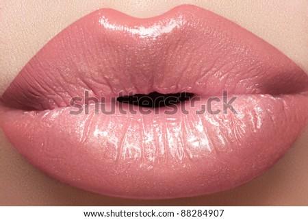 Gentle kiss. Beautiful fashion lip make-up. Macro of female lips with natural light makeup - stock photo