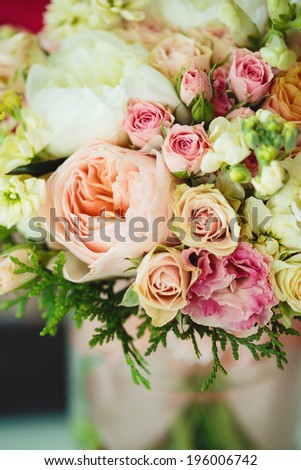 Gentle lovely bouquet with ranunculuses. Bridal flowers. Instagram effect, vintage colors. Selective focus.  - stock photo