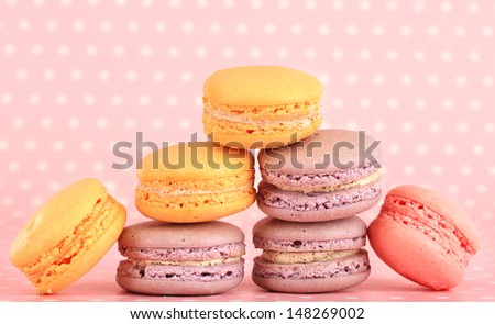 Gentle macaroons on pink background - stock photo