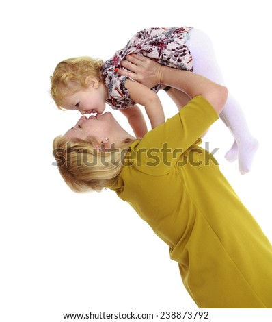 Gentle mother kisses his beloved daughter. Isolated on white background studio photo. - stock photo