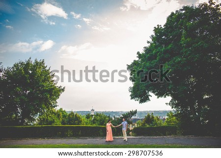 gentle romantic charming young stylish couple on a background of incredibly beautiful landscape, Lviv, summer - stock photo