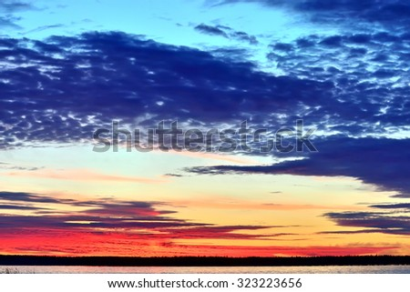Gentle sunset sky landscape in pastel colours - stock photo