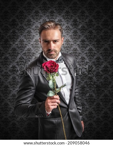 Gentleman gives a red rose on the anniversary - stock photo
