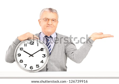 Gentleman sitting and holding a wall clock isolated against white background
