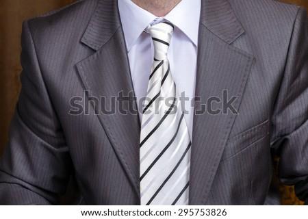 Gentleman wearing a black suit, shirt and tie, tuxedo - stock photo
