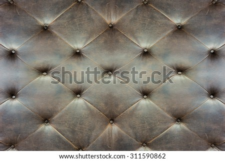 Genuine black leather upholstery background for a luxury decoration - stock photo