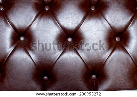 genuine brown leather texture - classic stylish upholstery button fabric quality skin sofa material, - stock photo