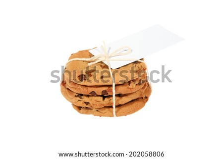 Genuine Chocolate Chip Cookies, they can also be medical cannabis cookies aka edibles. Tied together with a white string and a blank gift tag.  Isolated on white with room for your text. - stock photo