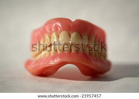 Genuine Dentures AKA False Teeth from a Dentist Office on white - stock photo