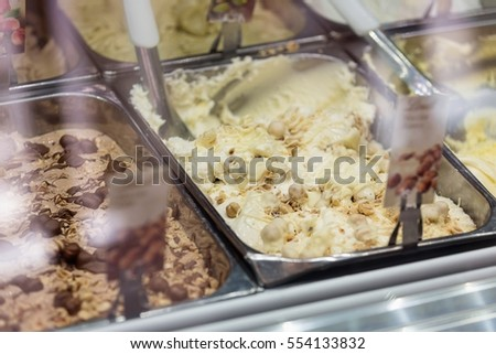 Genuine Italian ice - Variety of yummy ice creams under shopping window