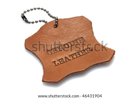 genuine leather label printed text burned into a piece of skin - stock photo