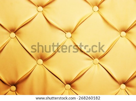 Genuine leather upholstery background for a luxury decoration in beige tones - stock photo