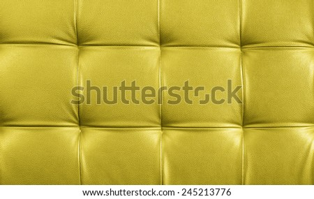 Genuine leather upholstery background for a luxury decoration in yellow tones - stock photo