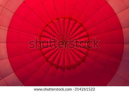 geometric abstract view inside a red hot air balloon - stock photo