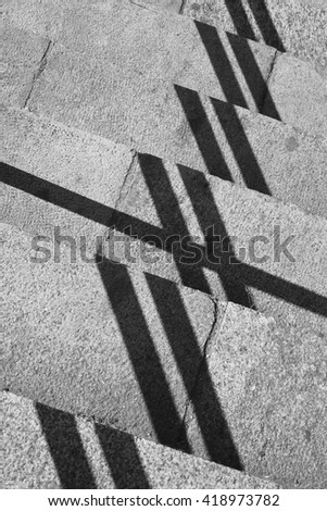 Geometric composition with shadows and stone steps outdoors