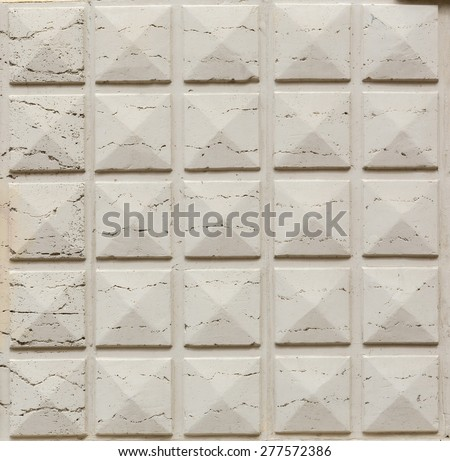 geometric decoration on the stone wall - stock photo