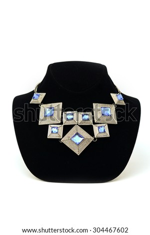 Geometric necklace set with precious stones on a mannequin