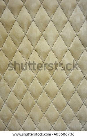 Geometric pattern embroidered on fabric, background, texture, pattern - stock photo