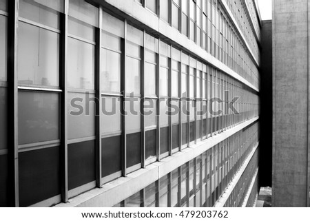 geometrical glass window pattern on bluidling wall in perspective - black and white urban city details