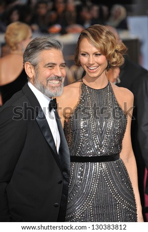 George Clooney & Stacy Keibler at the 85th Academy Awards at the Dolby Theatre, Hollywood. February 24, 2013  Los Angeles, CA Picture: Paul Smith - stock photo