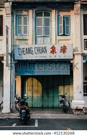 George Town,  Malaysia - March 22, 2016: Motorbikes parked near old shophouse building in UNESCO Heritage buffer zone in George Town, Penang, Malaysia on March 22, 2016.