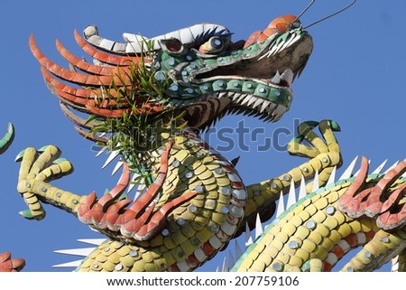 GEORGE TOWN, MALAYSIA - MAY 31: Intricate art adornment of the roof of the Hainan Temple in Georgetown, Malaysia on the 31st May, 2014.